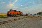 BNSF 6637 takes a NB baretable out of town.